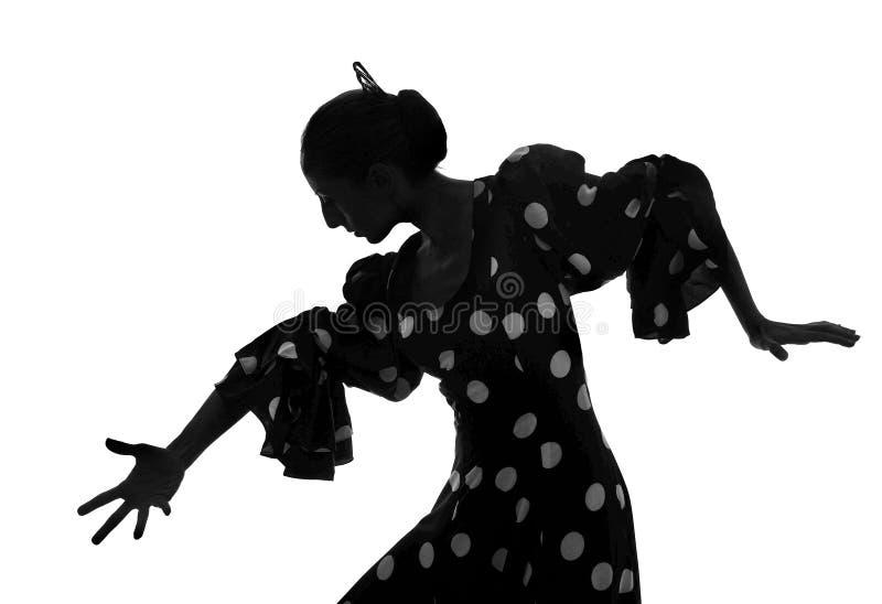 Kontur av den spanska kvinnaflamencodansaren som dansar Sevillanas arkivfoto