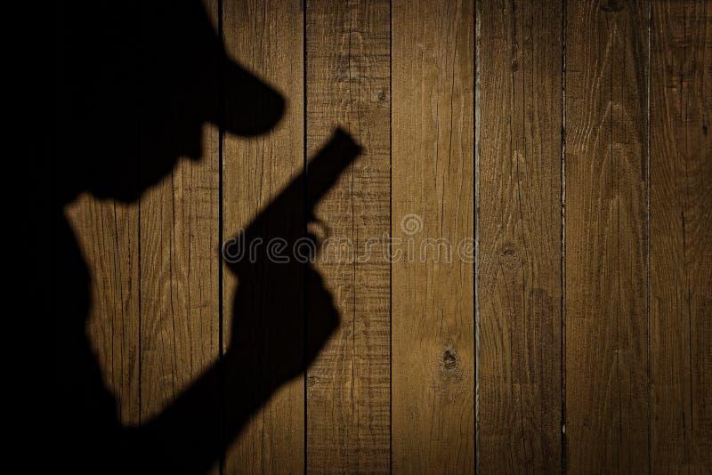 Kontur av en man med en handeldvapen, XXXL-bild royaltyfri fotografi