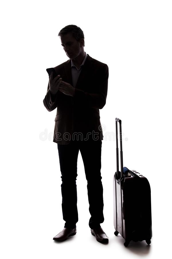Kontur av en resande affärsman Calling en rittaktie royaltyfria bilder