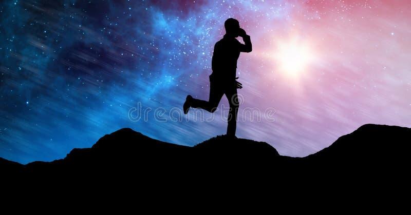 Konturaffärsmanspring på berg mot himmel på natten royaltyfria foton