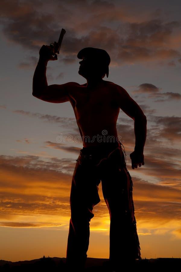 Konturcowboy ingen skjortapunktpistol upp arkivbilder