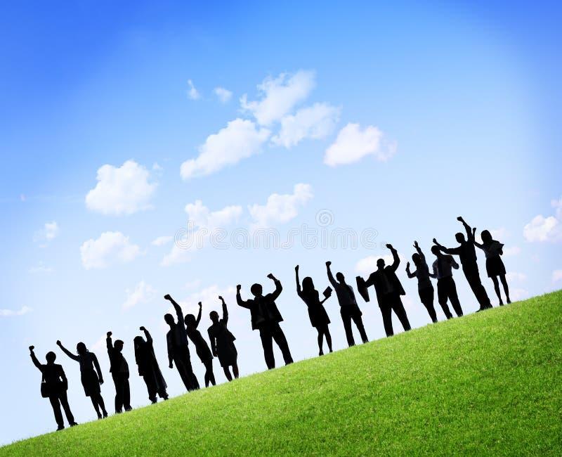 Konturer av affärsfolk med lyftta armar royaltyfria foton