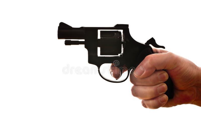 Konturn av a mans handen med en handeldvapen royaltyfri bild