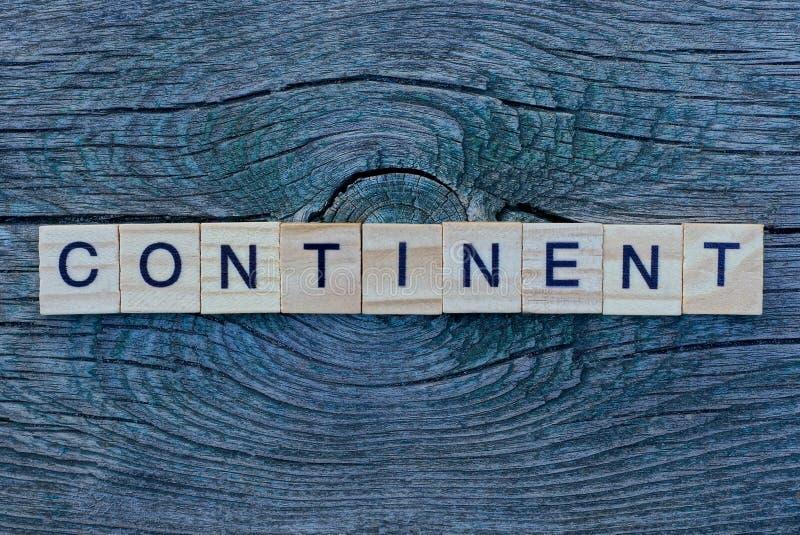 Kontynent słowny wykonany z drewnianych szarych liter zdjęcie stock