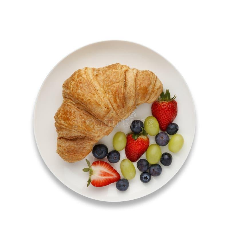 Kontynentalny śniadanie croissant owoc i, strzał od above, fotografia royalty free
