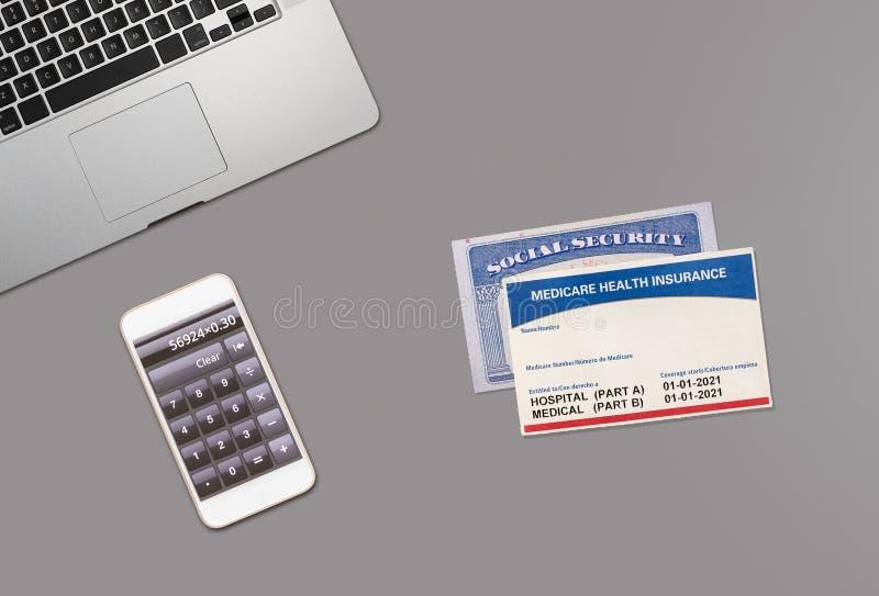 Konzept der sozialen Sicherheit und der medizinischen Versorgung mithilfe der Computertastatur lizenzfreies stockbild
