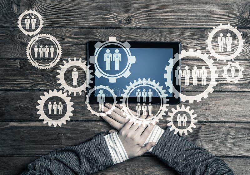 Konzept von Teamworking und von Verbindung mit Gangmechanismus und t stockbilder