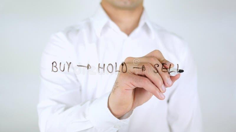Koop, houd, verkoop, Mens die op Met de hand geschreven Glas schrijven, royalty-vrije stock foto's