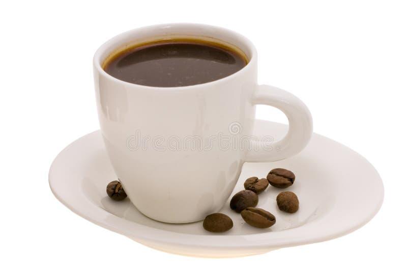 Kop met koffie en korrel stock foto's