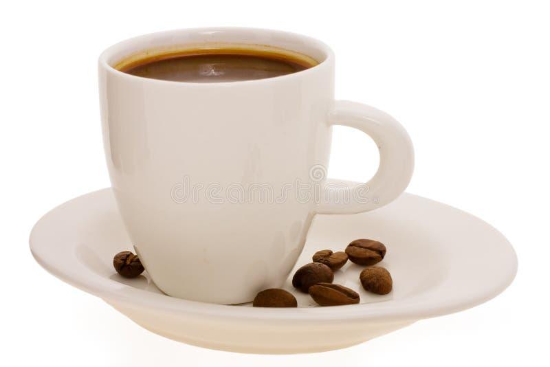Kop met koffie en korrel stock fotografie