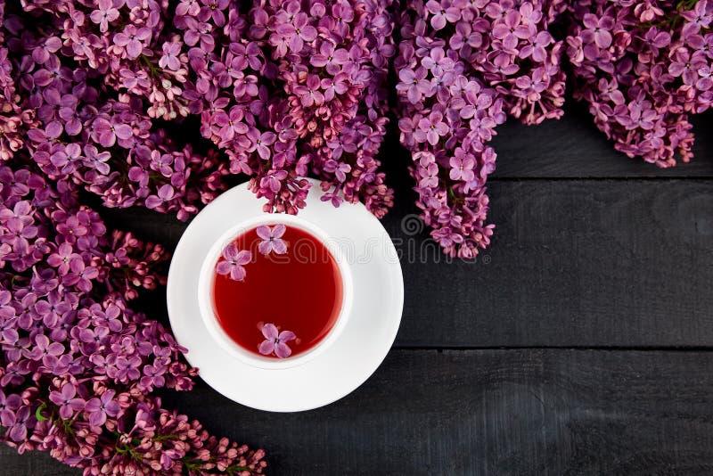 Kop thee en boeketsering stock afbeeldingen