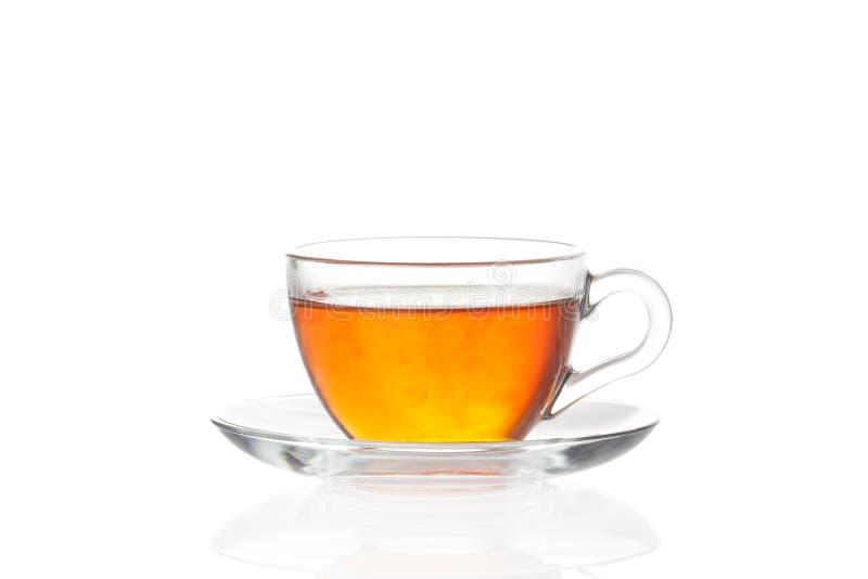 Kop thee met schotel op witte achtergrond stock fotografie