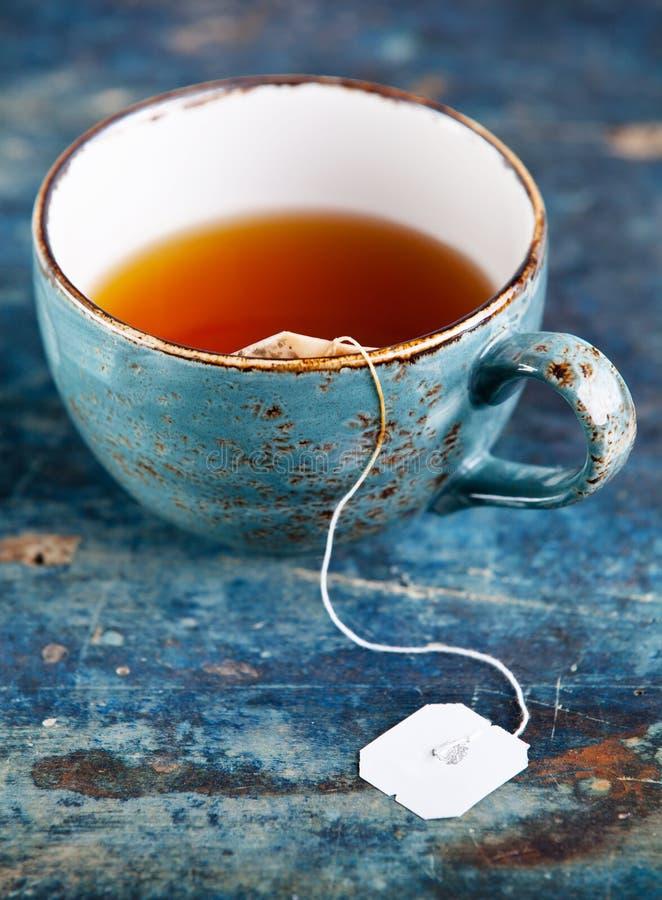Kop thee met theezakje stock afbeelding