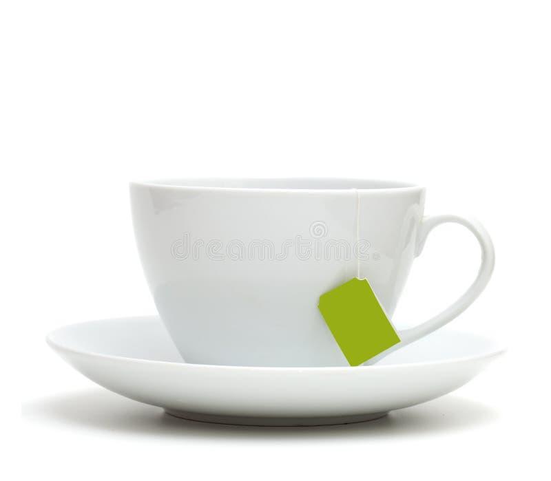 Kop thee met theezakje (leeg etiket) stock foto's