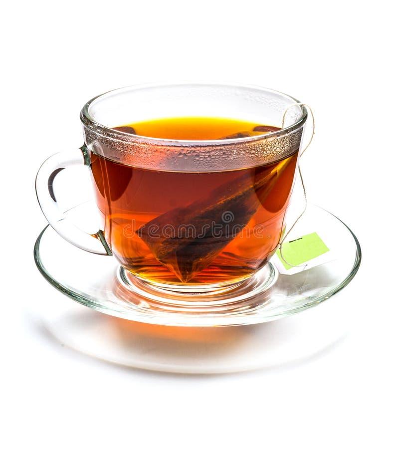 Kop thee met theezakje op wit wordt geïsoleerd dat stock foto