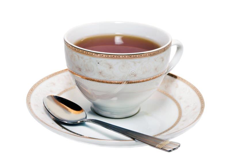 Kop thee op een schotel stock fotografie
