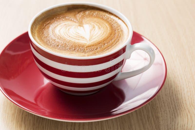 Kop van koffie met boom stock foto's