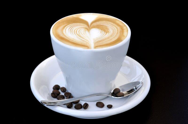 Kop van koffie met een hart stock foto