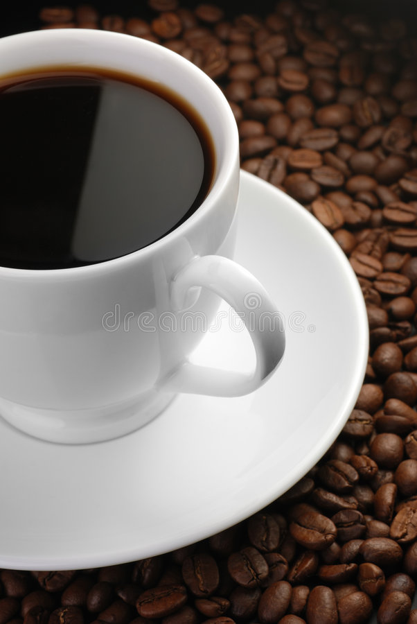 Kop van koffie met hoogtepunt royalty-vrije stock fotografie