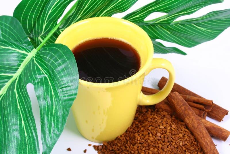 Kop van koffie met koffiegrai royalty-vrije stock foto's