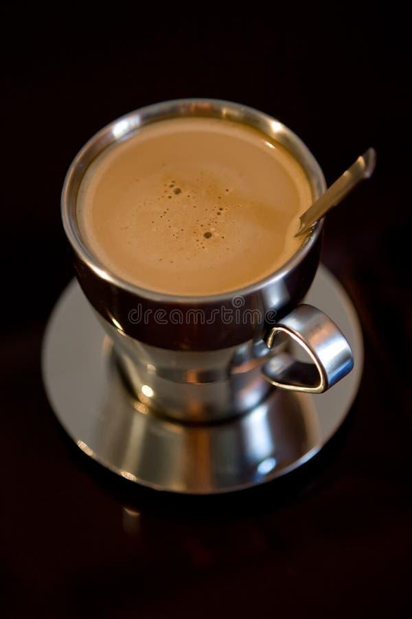 Kop van koffie met melk stock foto