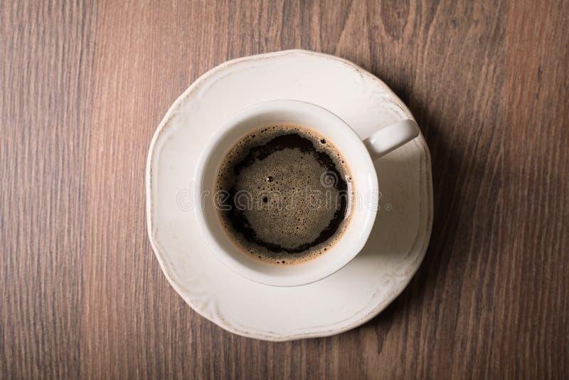 Kop van koffie op houten stock fotografie
