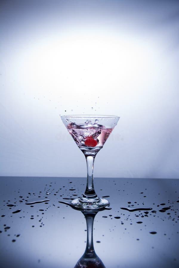Kop van wodka op witte achtergrond stock foto's