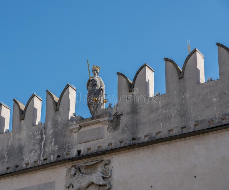Praetorian palace in old town of Koper in Slovenia. Koper, Slovenia - 24 May 2019: Statue of Justice on the top of the Praetorian palace in the old town of Koper royalty free stock images
