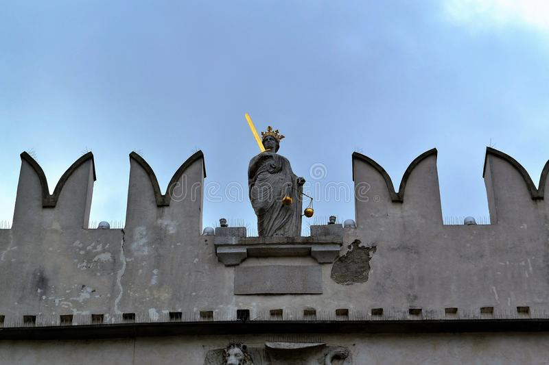 Koper Slovenia - Scenes from the town. Statue of the justice on the Pretorian palace royalty free stock images