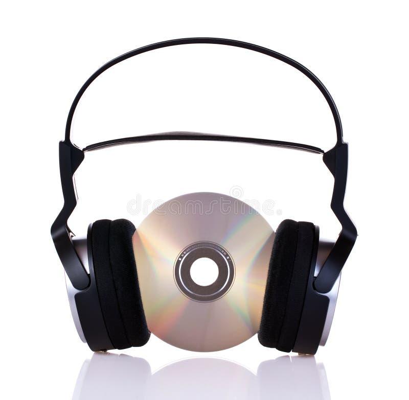 Kopfhörer auf einem Cd stockbilder