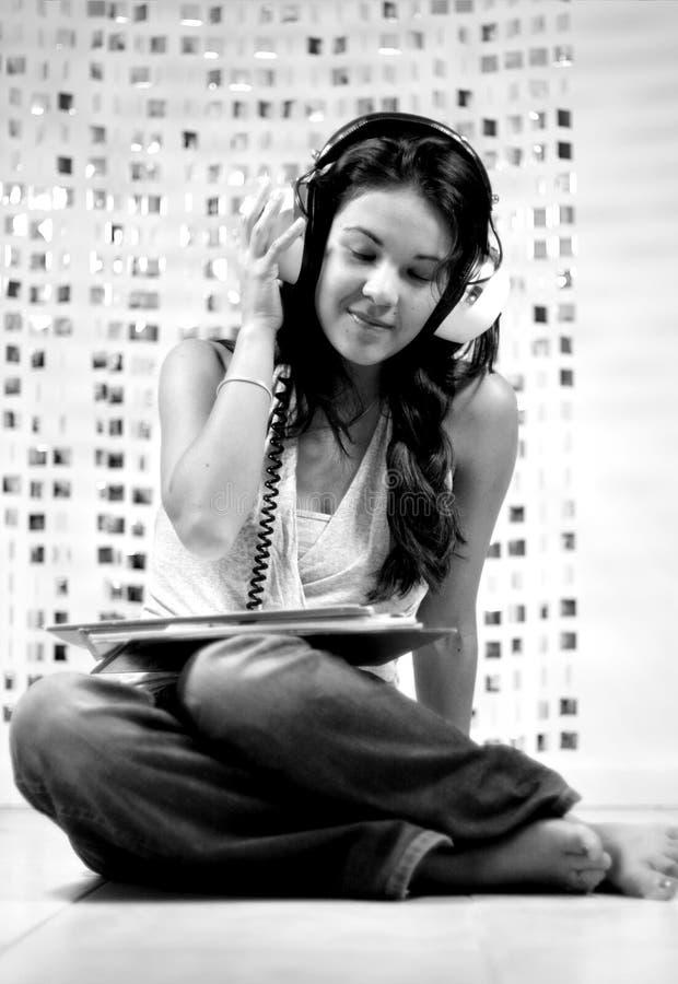Kopfhörerfrau lizenzfreie stockbilder