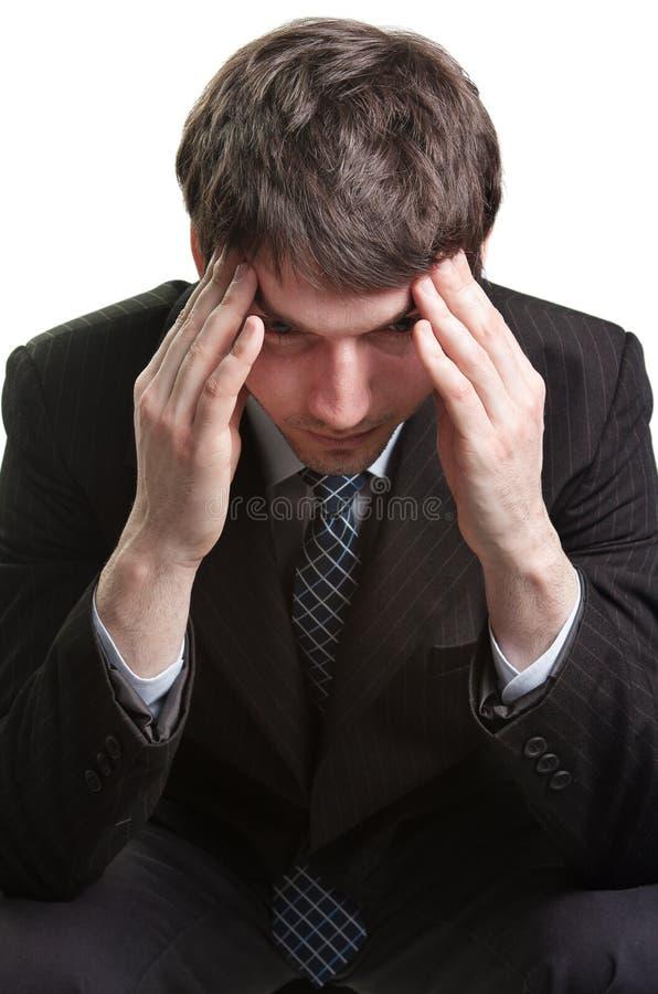 Kopfschmerzen eines müden und betonten Geschäftsmannes lizenzfreies stockbild