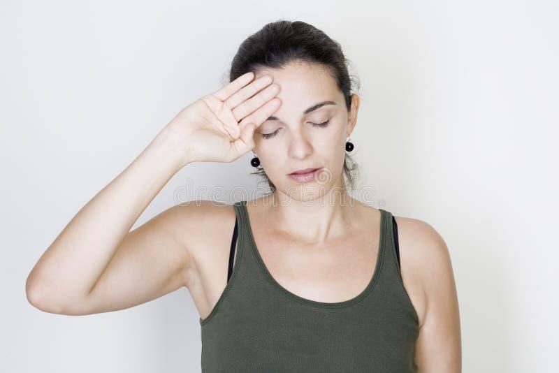 Kopfschmerzenfrau lizenzfreies stockfoto