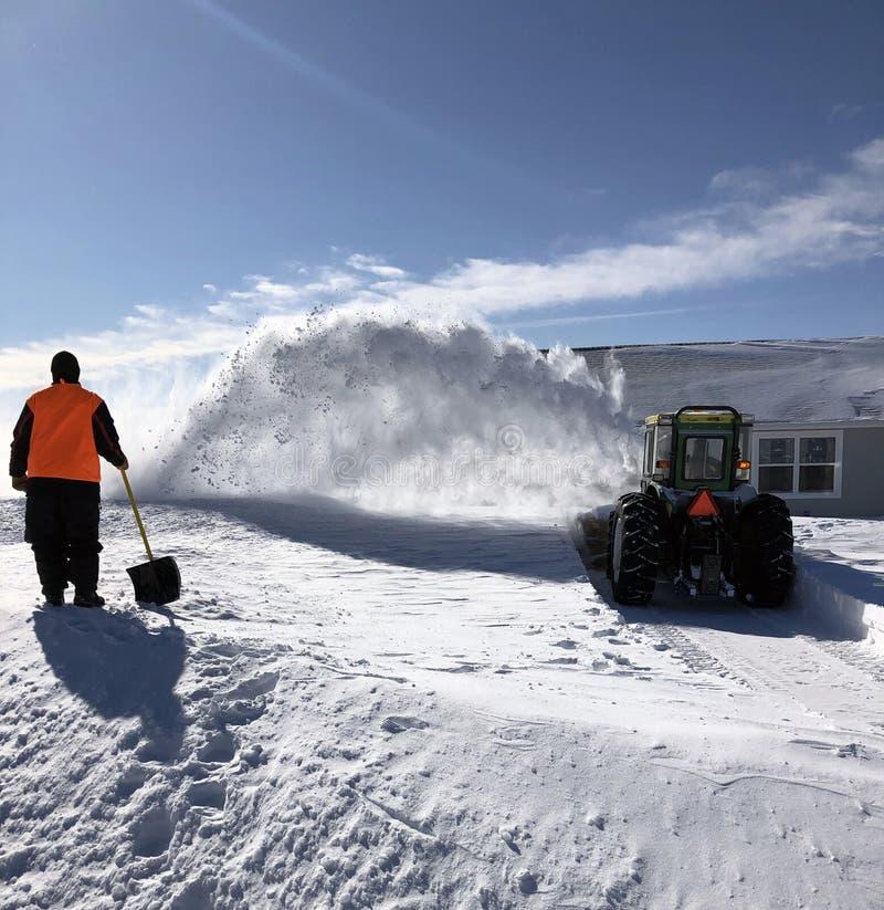 Kopiący za śnieżycy od zdjęcia stock