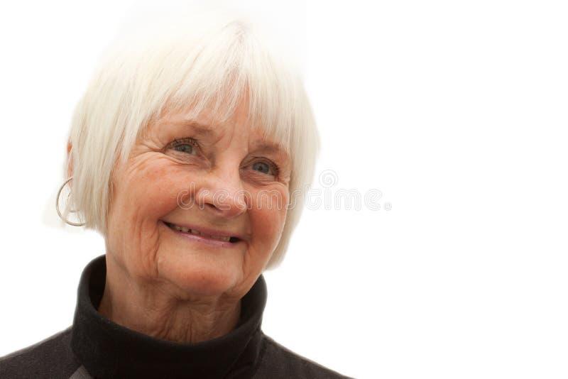 kopiera äldre lokal som ler till kvinnan royaltyfri bild