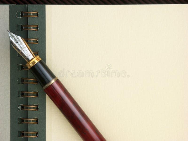 kopiera anteckningsbokpennavstånd fotografering för bildbyråer