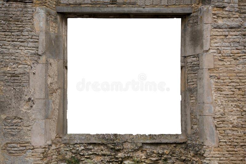 Kopieringsutrymme inom fönstret av en gammal tegelsten och stenen fördärvar royaltyfri fotografi