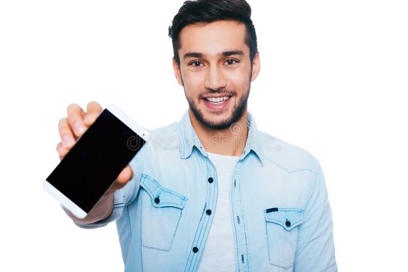 Kopieringsutrymme på hans smarta telefon royaltyfri bild