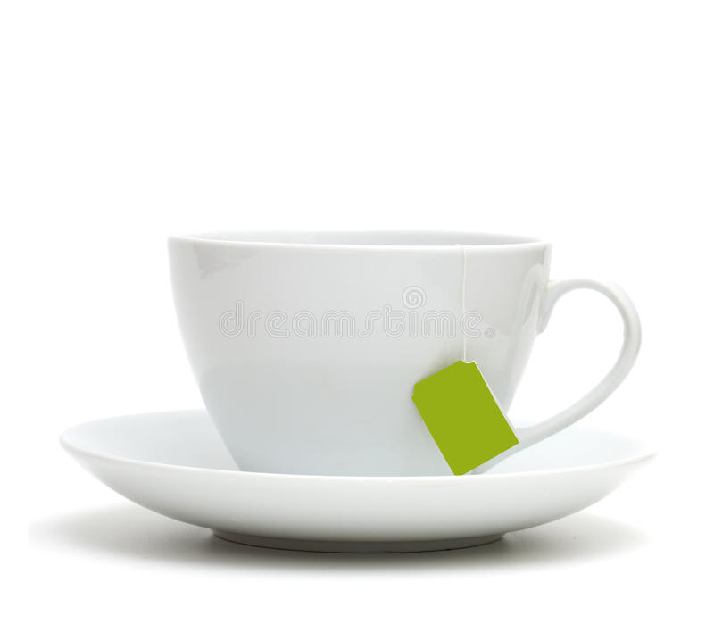 Kopp av tea med teapåsen (blank etiketten), arkivfoton
