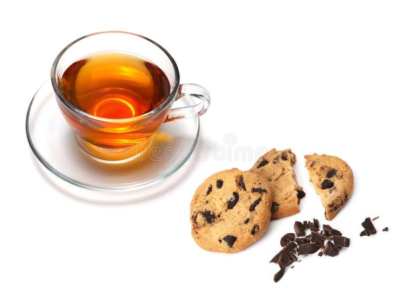 Kopp av tea och kakor arkivbild