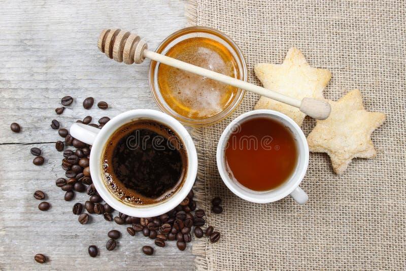 Kopp kaffe, kopp te och bunke av honung royaltyfri fotografi
