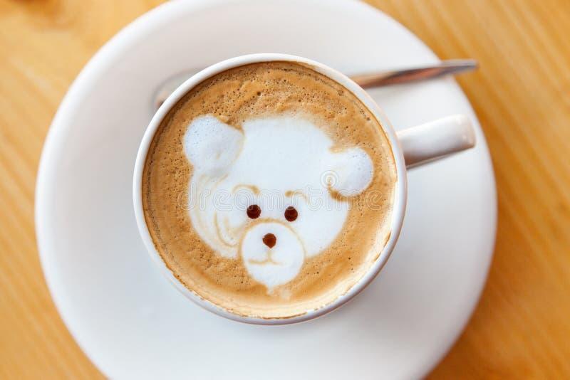 Kopp kaffe med garnering royaltyfria bilder
