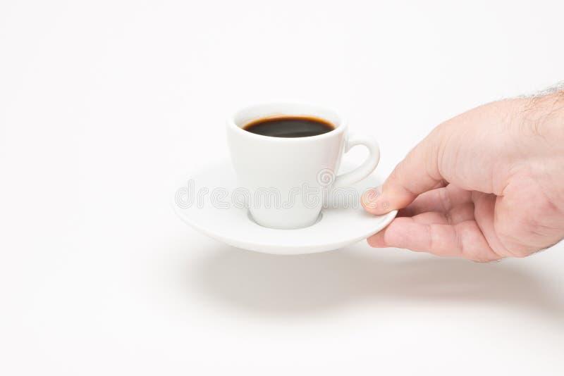 Kopp kaffe med handen royaltyfria foton