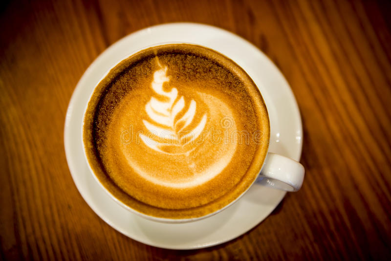 Kopp kaffe med lattekonst royaltyfria foton