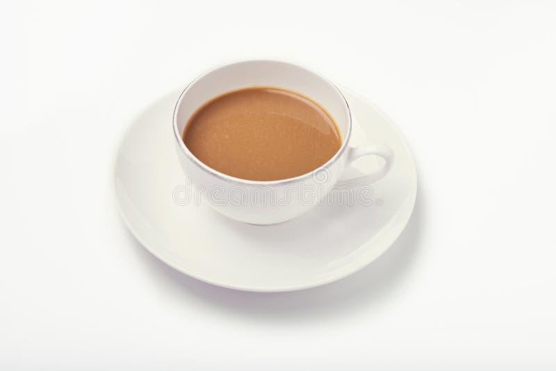 Kopp kaffe på viten arkivfoto