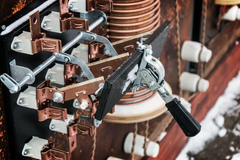 Koppardelar och beståndsdelar av den elektriska transformatorstartknappen royaltyfri bild