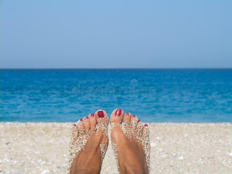 Koppla av på stranden arkivfoto