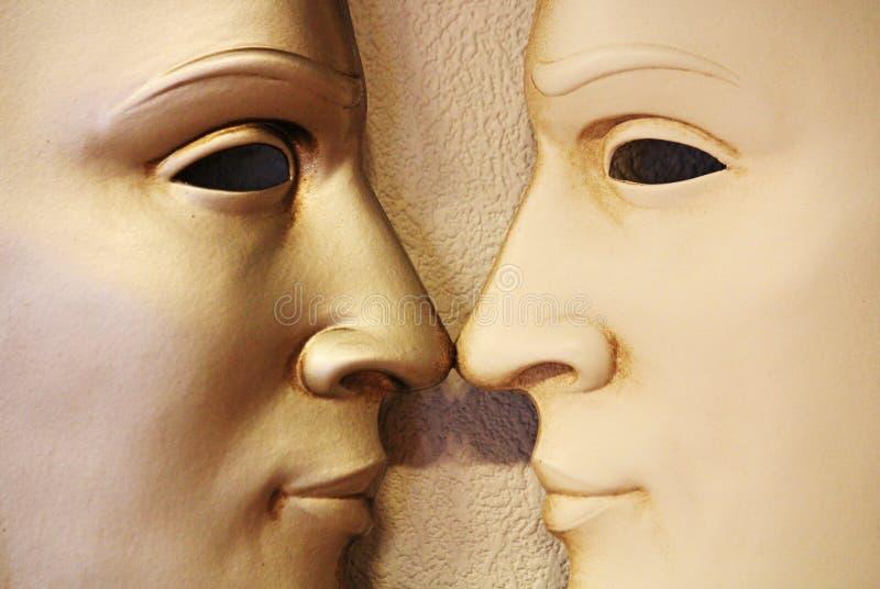 Kopplar samman - den Venetian maskeringen, Italien royaltyfri foto