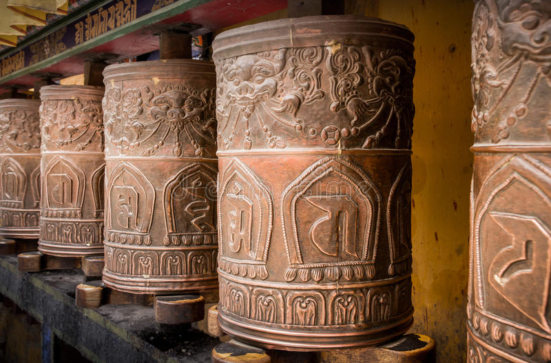 Kora Prayer wheels. Are religious objects installed in temples in Tibet and Nepal for people to spin for blessing stock photography