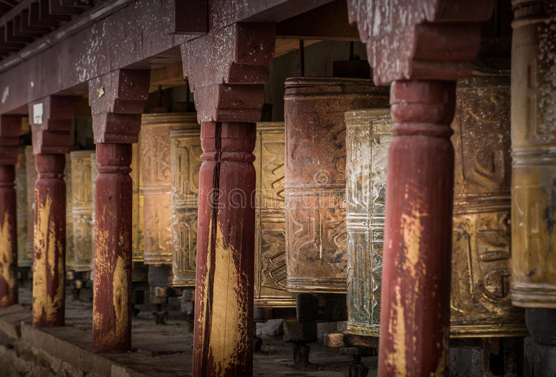 Kora Prayer wheels. Are religious objects installed in temples in Tibet and Nepal for people to spin for blessing stock photos